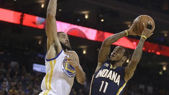 Indiana Pacers' Monta Ellis (11) shoots against Golden State Warriors' JaVale McGee, left, during the first half of an NBA basketball game Monday, Dec. 5, 2016, in Oakland, Calif. (AP Photo/Ben Margot)