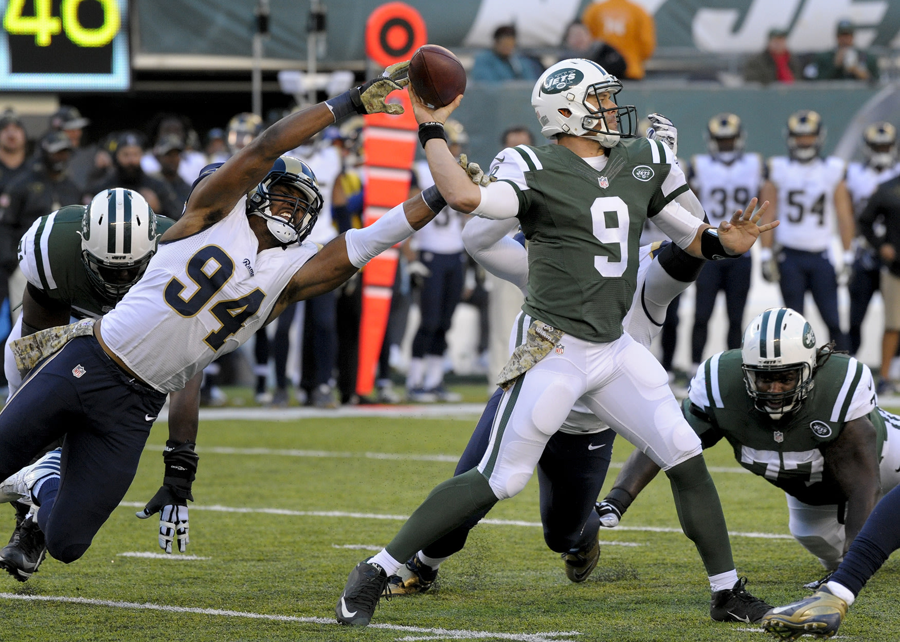 New York Jets quarterback Bryce Petty (9) throws under pressure from Los Angeles Rams defensive end Robert Quinn (94) during the third quarter of an NFL football game, Nov. 13, 2016, in East Rutherford, N.J. (Photo: Bill Kostroun/AP)