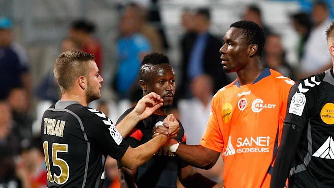 Stade de Reims' goalkeeper Kossi Agassa, center right, midfielder Bocundji Ca, center, and defender Atila Turan celebrate after defeating Marseille during their League One soccer match, at the Velodrome Stadium, in Marseille, southern France, Saturday, Oct. 26, 2013