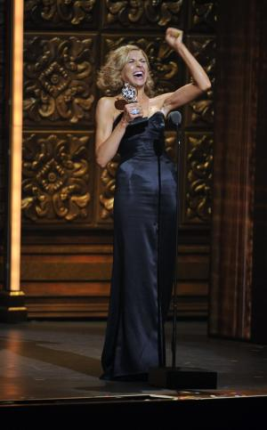 """Nina Arianda accepts the Tony for leading actress in a play for """"Venus in Fur,"""" at the 66th Annual Tony Awards on Sunday June 10, 2012, in New York. (Photo by Charles Sykes /Invision/AP)"""