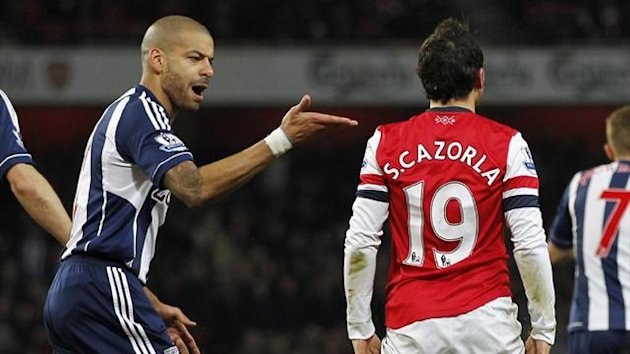 West Bromwich Albion's Steven Reid gestures to Arsenal's Santi Cazorla during the Premier League match in December 2012 (AFP)