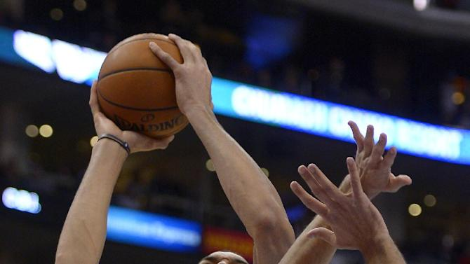 Utah Jazz center Rudy Gobert, left, of France, shoots as Los Angeles Clippers forward Hedo Turkoglu, of Turkey, defends during the first half of an NBA basketball game on Saturday, Feb. 1, 2014, in Los Angeles