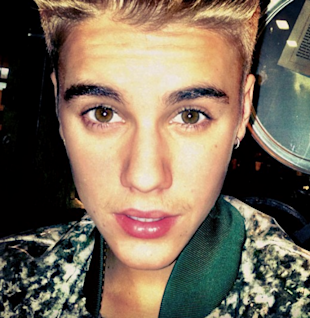 Growing Up? Justin Bieber Trys A New Look With A Moustache