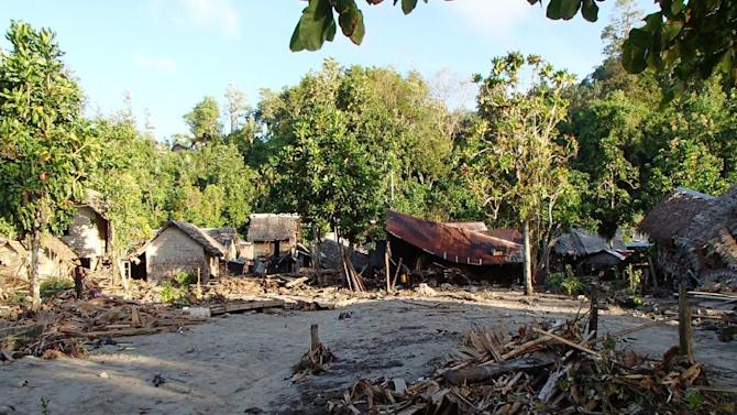 The destroyed Venga village following a Tsunami Wednesday Feb. 6, 2013, in Temotu province, Solomon Islands.  The damage seen is part the survey by the assessment crew of the aid organisation World Vision.  Solomon Islands authorities say at least four people are missing and presumed dead after an earthquake triggered a tsunami. Waves of up to 5 feet hit the western side of Santa Cruz Island and damaged up to 80 properties. Dozens of aftershocks have followed. Other tsunami warnings are canceled. (AP Photo / World Vision)