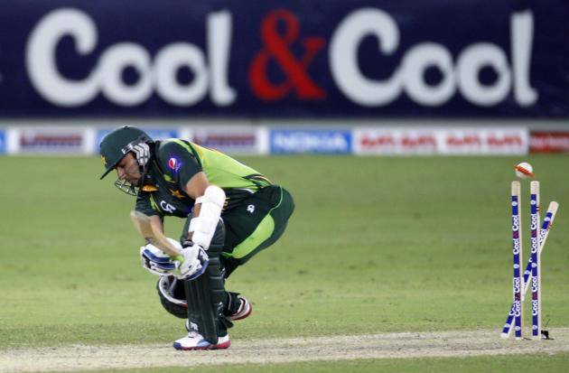 Pakistan's Saeed Ajmal gets bowled during their first Twenty20 international cricket match against South Africa in Dubai