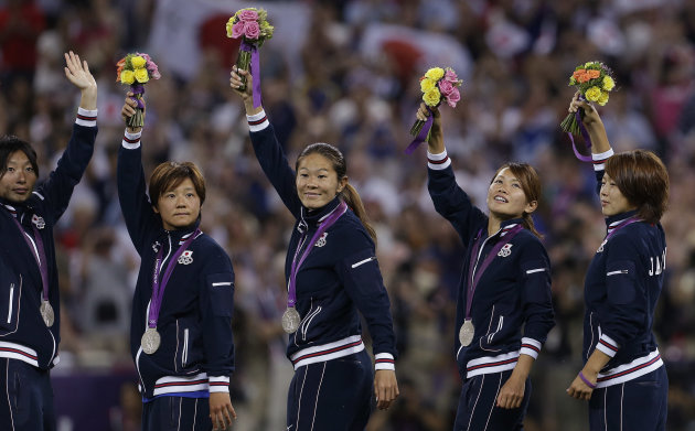 The Japanese women celebrate after earning the silver medal. (AP)
