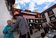 People gather to pray at a temple in Lhasa, Tibet in 2009. China on Sunday started work on a 30 bn yuan ($4.8 bn) tourism project in Lhasa city, state media said, as it seeks to draw more travellers to the restive Tibet region