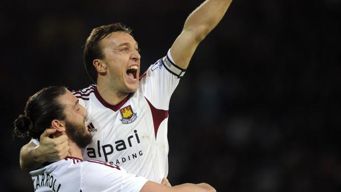 West Ham United's captain Mark Noble celebrates scoring a goal with teammate Andy Carroll during their English Premier League soccer match against Cardiff City at Cardiff City Stadium
