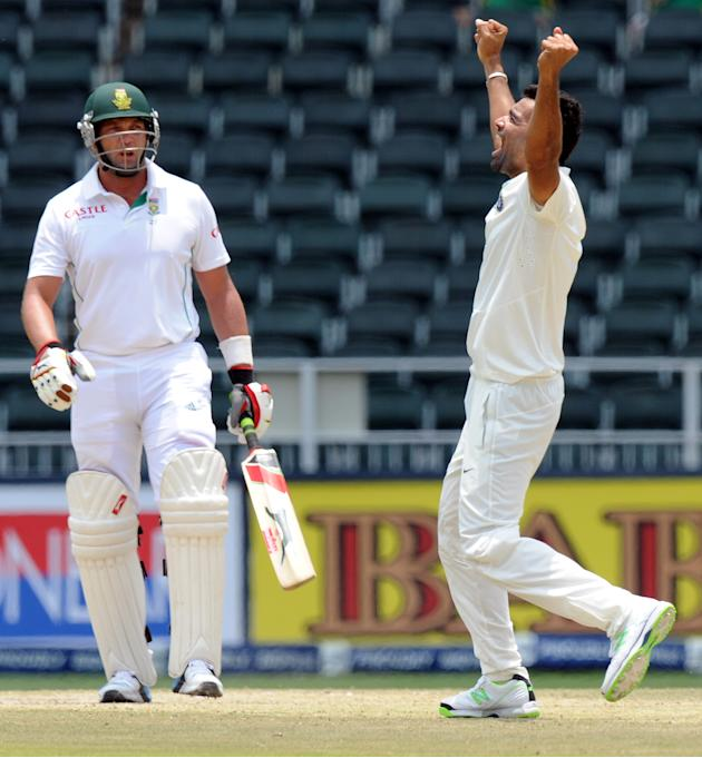 South African batsman (L) leaves after being bowled out by Indian bowler Zaheer Khan who is celebrating on the 5th day of a first cricket Test match between South Africa and India in Johannesburg at W