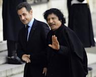 French President Nicolas Sarkozy (L) welcomes then Libyan leader Moamer Kadhafi in December 2007, at the Elysee Palace in Paris. Kadhafi's regime agreed to fund Sarkozy's 2007 election campaign to the tune of 50 million euros, a news website has reported