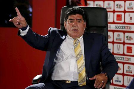 Argentina's former soccer player Diego Maradona speaks in the Soccerex Asian Forum at the Dead Sea