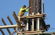 A construction worker at a building site for Bonifacio Global City in suburban Manila. The outsourcing workforce grew about 10 percent this year to 600,000, and is expected to expand to 900,000 employees by 2016