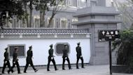Chinese paramilitary police patrol the grounds of the Communist Party provincial headoffice in Chongqing on March 15, 2012, the former office of Bo Xilai. Bo's wife is being investigated over the murder of British businessman Neil Heywood