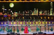 Chinese singer Peng Liyuan performs at the Grand Variety Show in Hong Kong, in 2007. Peng is a dazzling singer whose profile long eclipsed that of her husband Xi Jinping, and who will bring a touch of glamour to a role hidden in the shadows for decades