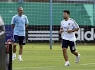 Sergio Aguero (R) jogs during a training session on September 8. Manchester City manager Roberto Mancini insists Aguero has a chance of featuring against Real Madrid on Tuesday despite the Argentina striker struggling to recover from an ankle problem