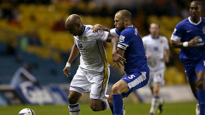 Leeds manager Neil Warnock says El-Hadji Diouf, left, is going nowhere