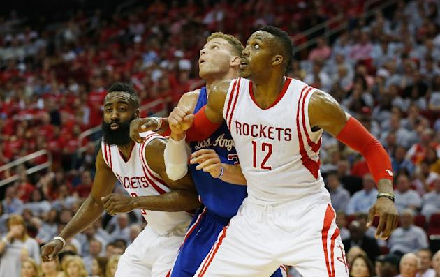 Houston Rockets' James Harden and Dwight Howard battle for position with Los Angeles Clippers' Blake Griffin during their game on May 4, 2015 at the Toyota Center