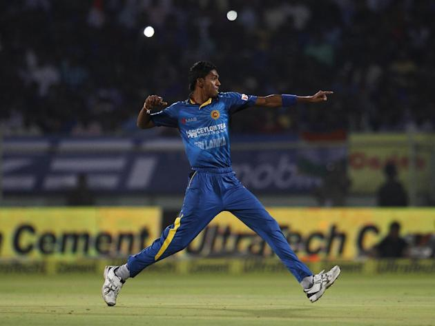 Sri Lanka's Dushmantha Chameera celebrates after taking the wicket of India's batsman Rohit Sharma during their third Twenty20 cricket match, in Vishakapatnam, India, Sunday, Feb. 14, 2016. (A