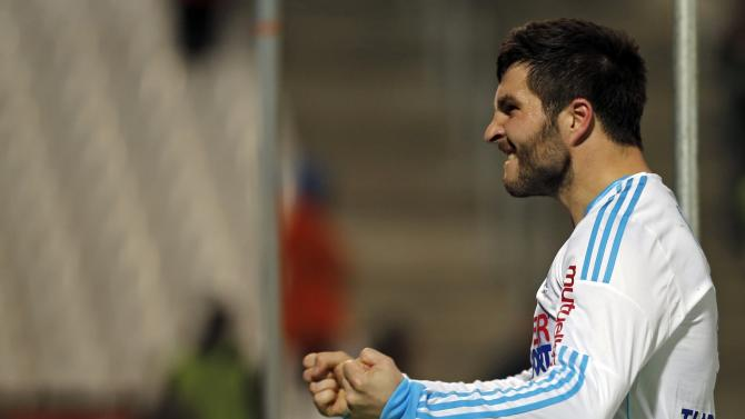 Olympique Marseille's Gignac celebrates after scoring against Bastia during their French Ligue 1 soccer match at the Velodrome stadium in Marseille