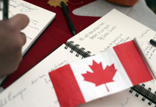 Words of condolence written for fallen Canadian soldiers Vincent and Cirillo. (Reuters)