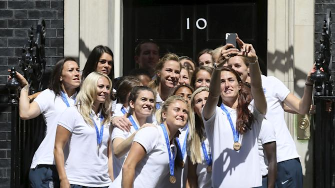 Members of the England womens football team pose for a selfie outside 10 Downing St in London