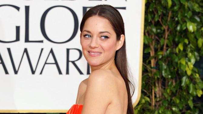 "FILE - This Jan. 13, 2013 file photo shows actress Marion Cotillard at the 70th Annual Golden Globe Awards in Beverly Hills, Calif. Cotillard has been named the 2013 Harvard University Hasty Pudding Theatricals Woman of the Year. The French actress, who won the 2007 best actress Oscar for her role in ""La Vie En Rose,"" will be honored with a parade and roast, and given her ceremonial pudding pot, at Harvard on Jan. 31. (Photo by John Shearer/Invision/AP, file)"