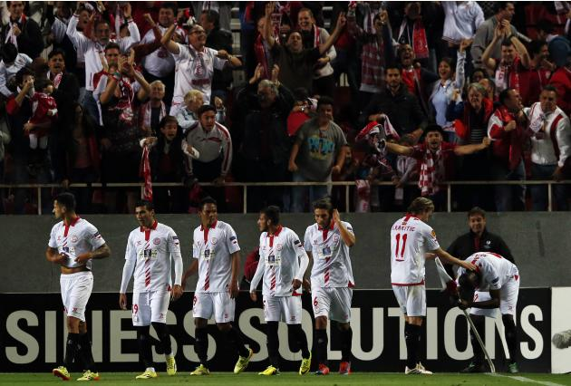 Sevilla's Mbia celebrates with teammates after scoring against Valencia during their Europa League semi-final first leg soccer match in Seville