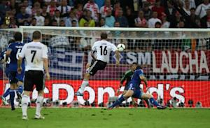 Germany's Philip Lahm scores the opening goal of the game