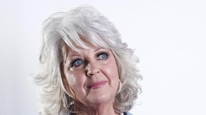 "FILE - In this Jan. 17, 2012 file photo, celebrity chef Paula Deen poses for a portrait in New York. The celebrity chef dissolved into tears during a ""Today"" show interview Wednesday, June 26, 2013, trying to explain she wasn't a racist despite saying in a legal deposition that she's used racial slurs in the past. (AP Photo/Carlo Allegri, File)"