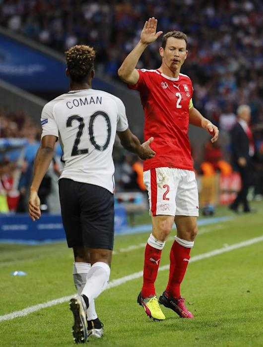 Switzerland's Stephan Lichtsteiner and France's Kingsley Coman