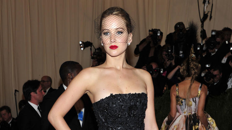 "Jennifer Lawrence attends The Metropolitan Museum of Art's Costume Institute benefit celebrating ""PUNK: Chaos to Couture"" on Monday May 6, 2013 in New York. (Photo by Charles Sykes/Invision/AP)"