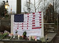 The names of victims of the Sandy Hook elementary school shooting are displayed on a flag in the business area of Newtown, Connecticut, on December 16, 2012