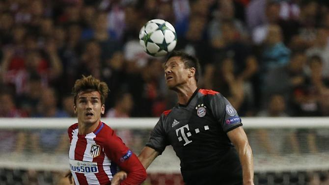 Atletico Madrid's Antoine Griezmann in action with Bayern Munich's Xabi Alonso