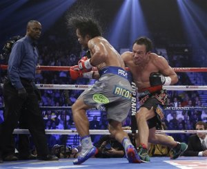 Juan Manuel Marquez connects against Manny Pacquiao. (AP)