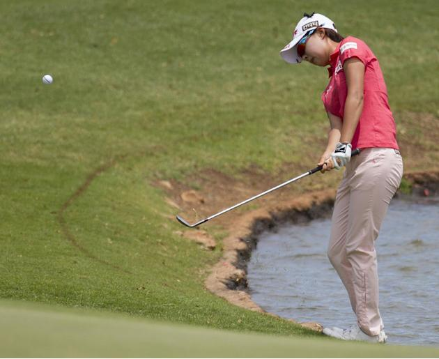 Hyo Joo Kim, of South Korea, chips onto the fifth green in the final round of the LPGA LOTTE Championship golf tournament at Ko Olina Golf Club, Saturday, April 19, 2014, in Kapolei, Hawaii