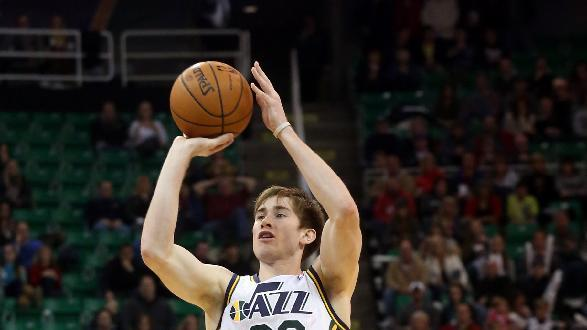 Utah Jazz's Gordon Hayward (20) takes a shot in the second half of an NBA basketball game against the Sacramento Kings on Saturday, Dec. 7, 2013, in Salt Lake City. The Kings went on to win 112-102 in overtime