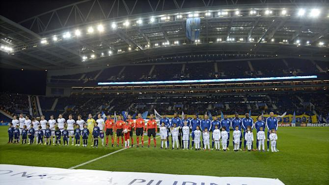 "Vienna and Porto soccer teams line-up prior to their Champions League group G soccer match between FC Porto and Austria Vienna Tuesday, Nov. 26, 2013, at the Dragao stadium in Porto, northern Portugal. The message on a banner reads ""You are not alone, Philippines"", as European football remembers the victims of the 8 November typhoon"