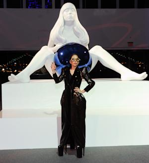 Lady Gaga unveils a sculpture of herself by artist Jeff Koons during the ARTPOP album release and artRave event at the Brooklyn Navy Yard on Sunday, Nov. 10, 2013 in New York. (Photo by Evan Agostini/Invision/AP)