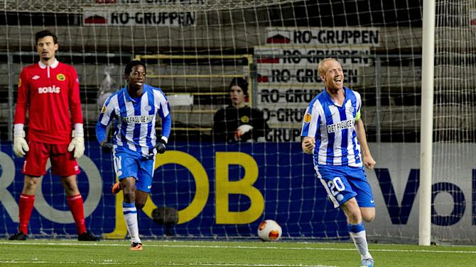 Esbjerg's Hans Henrik Andreasen, right, celebrates scoring with teammate Mushaga Bakenga as Elfsborg's goalkeeper Kevin Stuhr-Ellegaard, left, looks on during the group C Europa League soccer match at the Boras Arena in Boras, Sweden, Thursday Oct. 24, 2013
