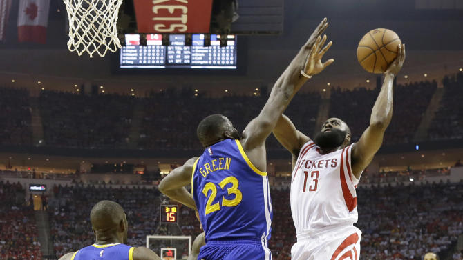 Houston Rockets guard James Harden (13) shoots over Golden State Warriors forward Draymond Green (23) during the first half in Game 3 of the Western Conference finals of the NBA basketball playoffs, Saturday, May 23, 2015, in Houston. (AP Photo/David J. Phillip)