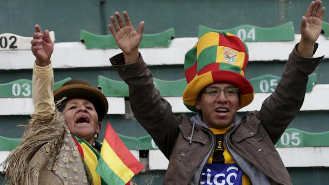 Fans of Bolivia cheer before the team's 2018 World Cup qualifying soccer match against Uruguay at the Hernando Siles Stadium in La Paz