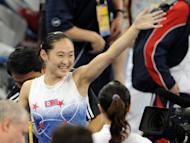 North Korea's Un Jong-Hong waves to spectators after winning the gold in the women's vault final of the artistic gymnastics event of the Beijing 2008 Olympic Games. In Beijing, N.Korea won two gold, one silver and three bronze medals to finish in 34th place overall