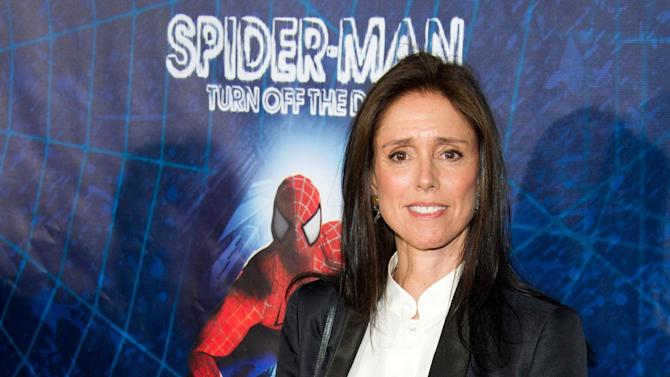"FILE - In this June 14, 2011 file photo, Julie Taymor arrives at the opening night performance of the Broadway musical ""Spider-Man Turn Off the Dark"" in New York. A settlement has been reached between the producers of ""Spider-Man: Turn Off the Dark"" and its fired director, Julie Taymor. Both sides on Wednesday, April 10, 2013, said in a statement that: ""All claims between all of the parties in the litigation have been resolved.""  Taymor filed a lawsuit in November 2011, saying her copyrighted written works were violated when she was fired last year and the musical's script was rewritten after the $75 million production had trouble getting past previews. (AP Photo/Charles Sykes, file)"