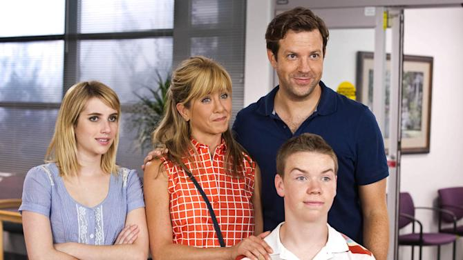 """This film image released by Warner Bros. Entertainment shows, from left, Emma Roberts, Jennifer Aniston, Jason Sudeikis, background right, and Will Poulter in a scene from """"We're the Millers."""" (AP Photo/Warner Bros. Entertainment, Michael Tackett)"""