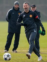 Manchester United midfielder Ryan Giggs is pictured during a team training session in Manchester on March 4, 2013. Giggs is poised to make his 1,000th appearance in senior football on Tuesday after being rested at the weekend