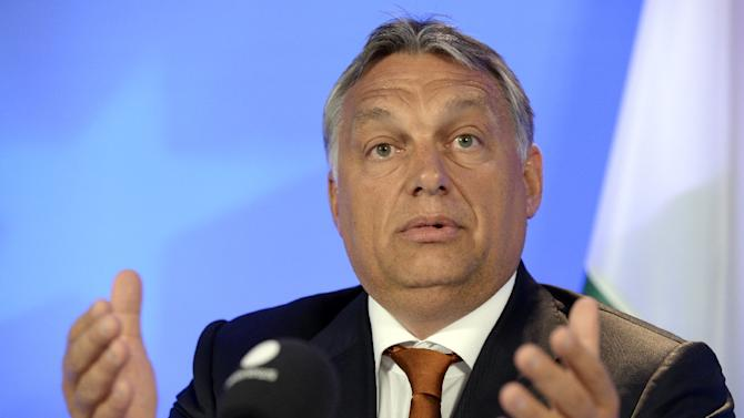 """Hungary's Prime Minister Viktor Orban says his country has a """"democratic right"""" to a different approach on the migrant crisis"""