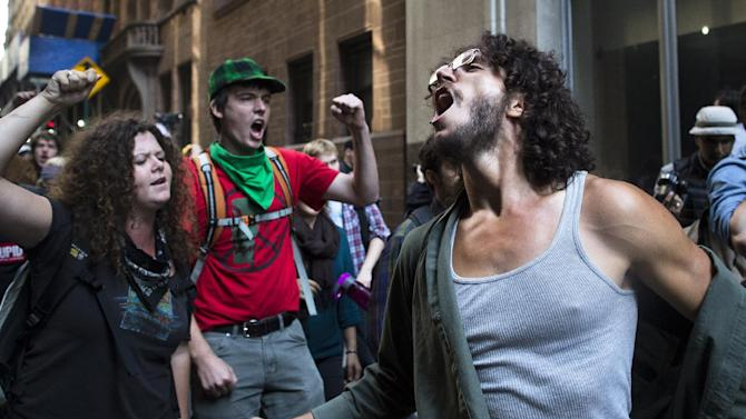 Occupy Wall Street protestors chant during a march in the Financial District, Monday, Sept. 17, 2012, in New York. Multiple Occupy Wall Street protestors have been arrested during a march toward the New York Stock Exchange on the anniversary of the grass-roots movement. (AP Photo/John Minchillo)