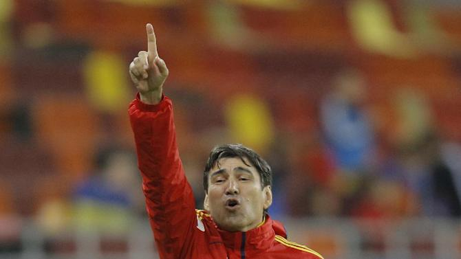Romania's coach Victor Piturca gestures during the World Cup Group D qualifying soccer match against Estonia at the National Arena stadium in Bucharest, Romania, Tuesday, Oct. 15, 2013