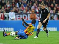Bayern Munich's midfielder Bastian Schweinsteiger (R) scores past Valencia's defender Aly Cissokho during their UEFA Champions League group F football match in the southern German city of Munich. Bayern won 2-1
