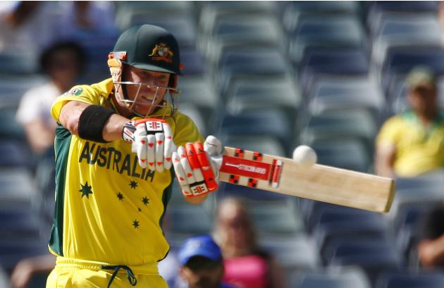 Australia's batsman David Warner swing the ball to the boundary for four runs during their Cricket World Cup match against Afghanistan in Perth